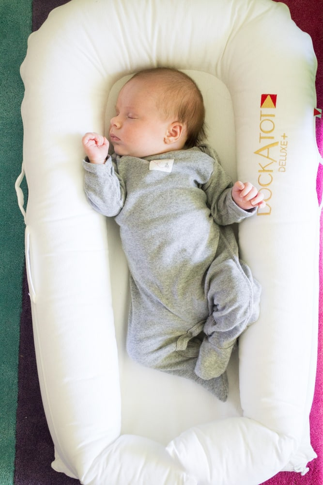 First Time Mom Review of the DockaTot and how we use it as a lounger and travel sleeper. Our baby loves napping with DockaTot!