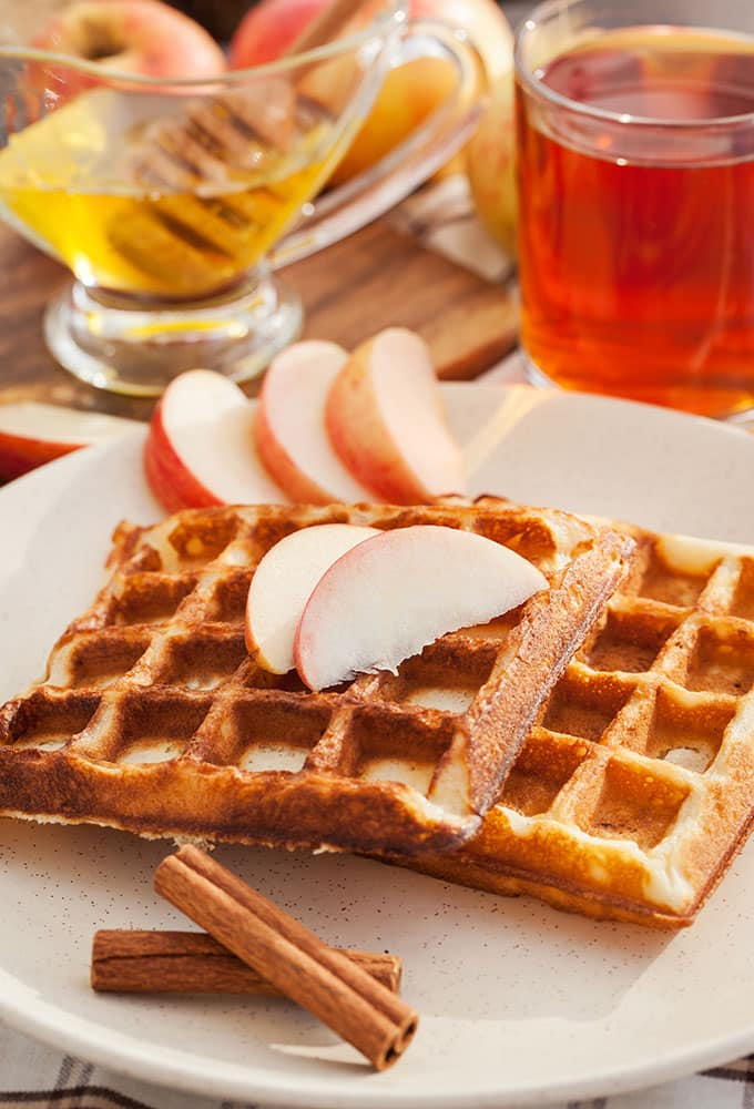 EASY Apple Waffles recipe! These healthy waffles include fresh shredded apples and cinnamon! They are simple to make for a Fall breakfast! Serve with maple syrup on top!