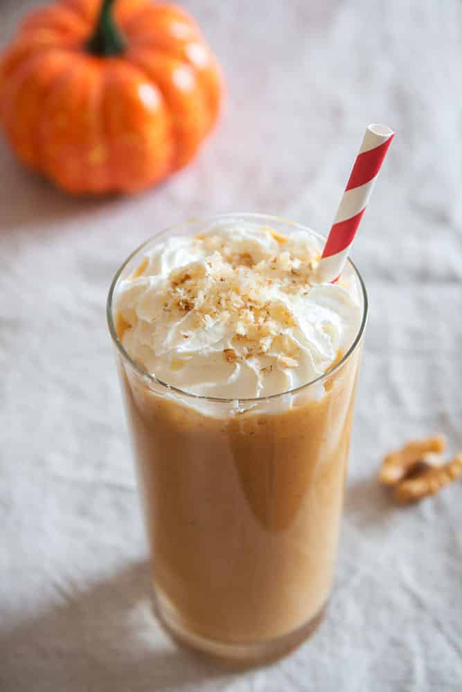 Easy PUMPKIN PIE Milkshake! This easy milkshake recipe uses 1 slice of PUMPKIN PIE to make the BEST tasting pumpkin milkshake!  This drink only requires 4 simple ingredients, including vanilla ice cream and milk!  It's a perfect Fall Thanksgiving dessert and is a great solution if you have too much pumpkin pie!