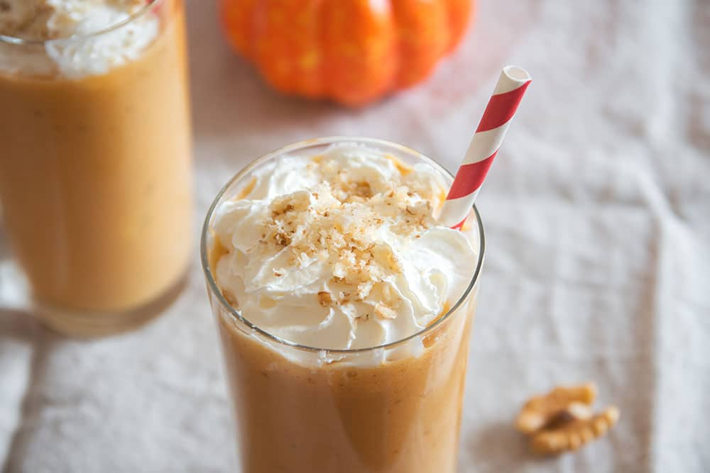 Easy PUMPKIN PIE Milkshake! This easy milkshake recipe uses 1 slice of PUMPKIN PIE to make the BEST tasting pumpkin milkshake you ever tasted!  This drink only requires 4 simple ingredients, including vanilla ice cream and milk!  It's a perfect Thanksgiving dessert and is a great solution if you have too much pumpkin pie!