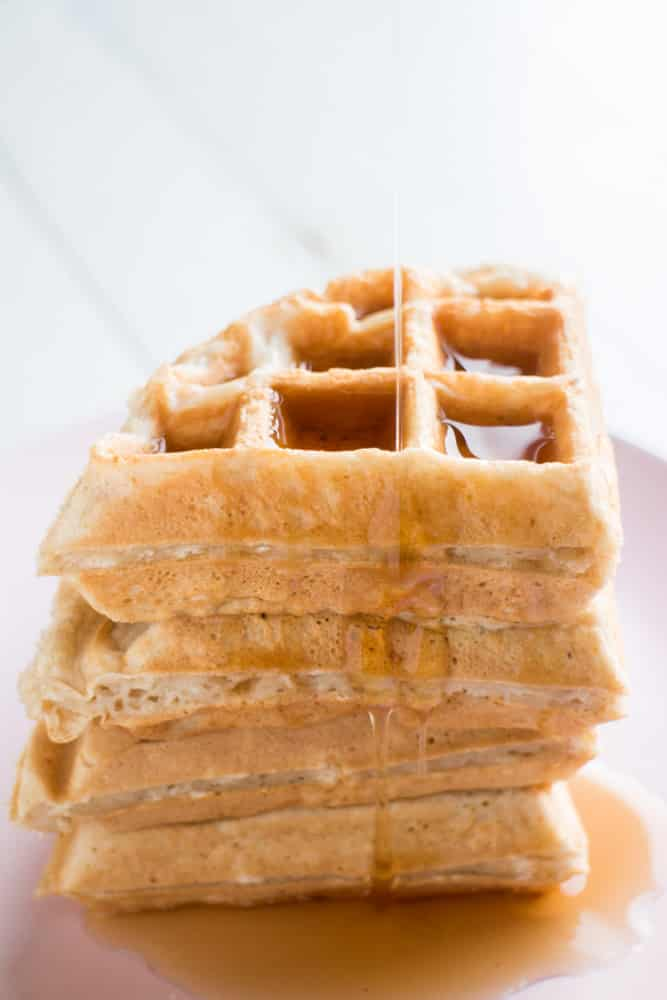 NO BUTTER NEEDED Fluffy Waffles! This easy breakfast recipe calls for applesauce instead of butter making these waffles a healthy option! I love these homemade from scratch waffles, they are so fluffy and my family always says they're the best Saturday morning breakfast!