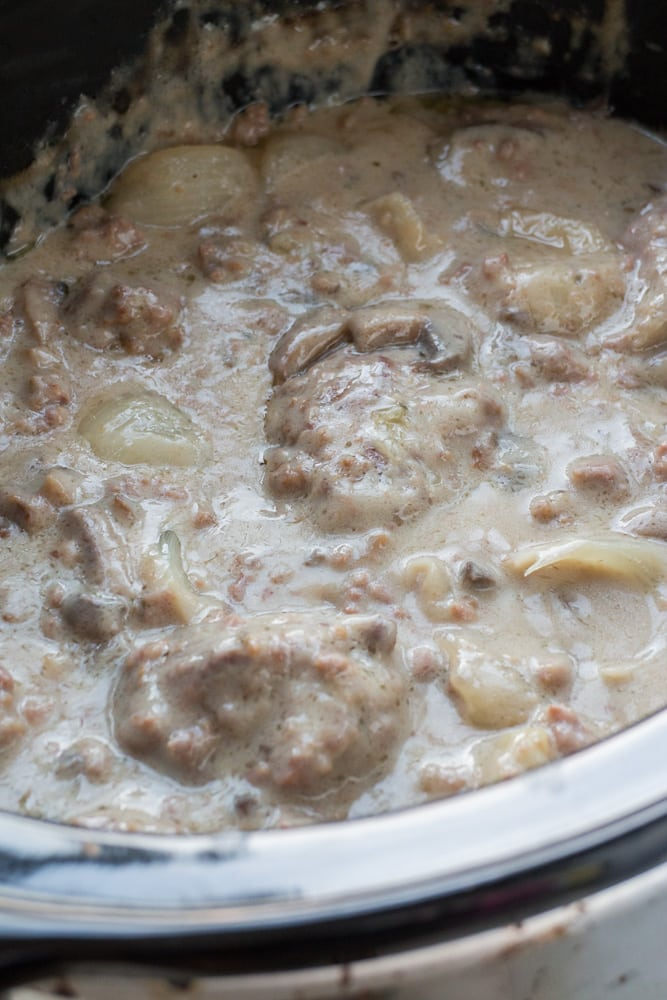 I LOVE this SLOW COOKER Salisbury Steak With Cream of Mushroom Soup! This CROCKPOT recipe is easy to make and is ready in 5 hours! It's made with dry onion soup mix and cream of mushroom soup to make a comforting gravy your entire family is going to love! I always serve on egg noodles or with mashed potatoes! This is one of my favorites simple weeknight meals!