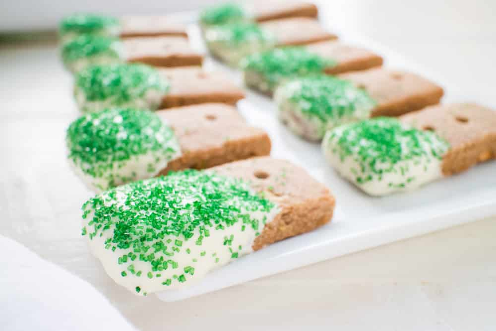 GLUTEN-FREE White Chocolate Dipped Pistachio Cookies are the BEST for CHRISTMAS baking! This easy gluten-free recipe makes 48 spiced pistachio cookies that are dipped in melted white chocolate! They are made with almond flour and teff flour, making a perfectly formed cookie! They are one of my favorite Christmas cookies, perfect for family eating and holiday gifts!