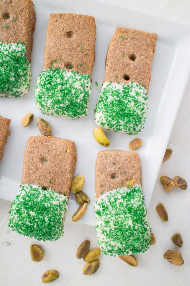 GLUTEN-FREE White Chocolate Dipped Pistachio​ ​​Cookies​ are the BEST for CHRISTMAS baking! This easy gluten-free recipe makes 48 spiced pistachio cookies that are dipped in melted white chocolate! They are made with almond flour and teff flour, making a perfectly formed cookie! They are one of my favorite Christmas cookies, perfect for family eating and holiday gifts!