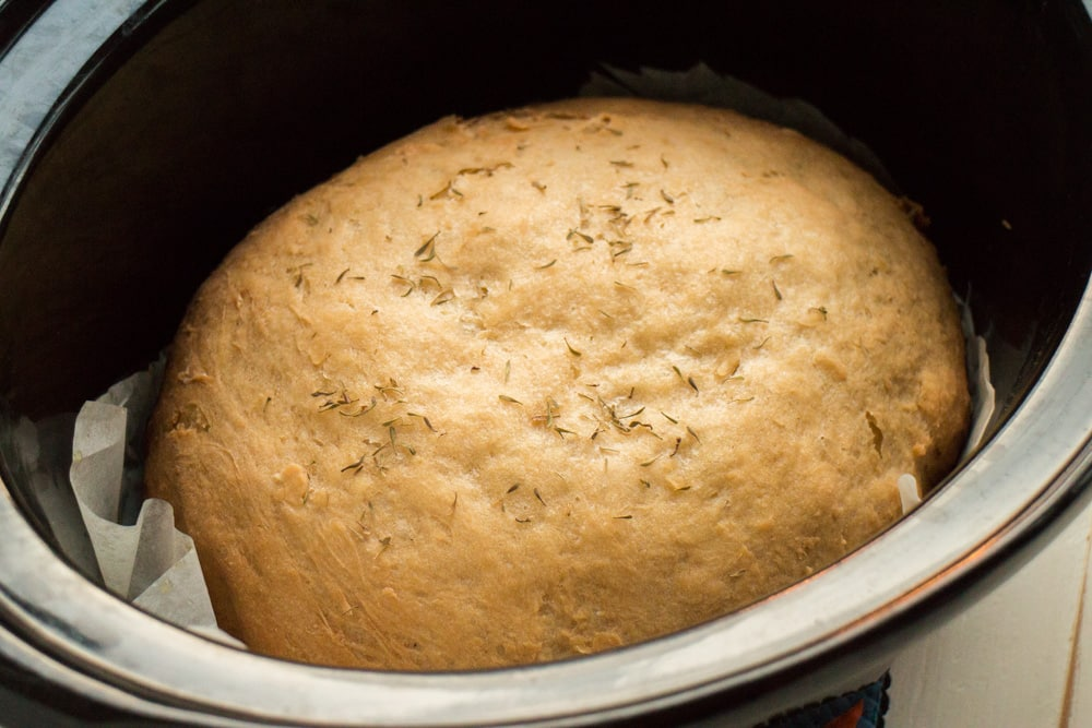 2 HOUR Slow Cooker Bread! This homemade bread is so EASY to make and has changed my life! Throw it in the crock pot and you will have soft, moist bread in 2 hours! This is the best bread to serve with creamy soups and casseroles, it tastes like Amish Sweet Bread!