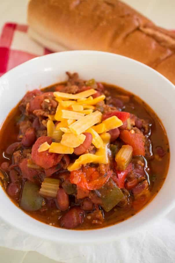 PAMELA'S Slow Cooker Pork Chili is made with BACON and SAUSAGE! This pork chili is one of the easiest crockpot recipes with diced tomatoes and beans! If you're looking for dinner ideas to make as your family's favorite comfort food dinners, then this it!   Ready in 6 hours on LOW. Serve with shredded cheese and a big piece of crusty bread!