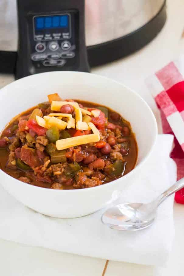 PAMELA'S PORKY Slow Cooker CHILI is made with BACON and SAUSAGE! This pork chili is easy to make in the crockpot with diced tomatoes and beans! It's one of my families favorite comfort food dinners!   Ready in 6 hours on LOW. Serve with shredded cheese and a big piece of crusty bread!