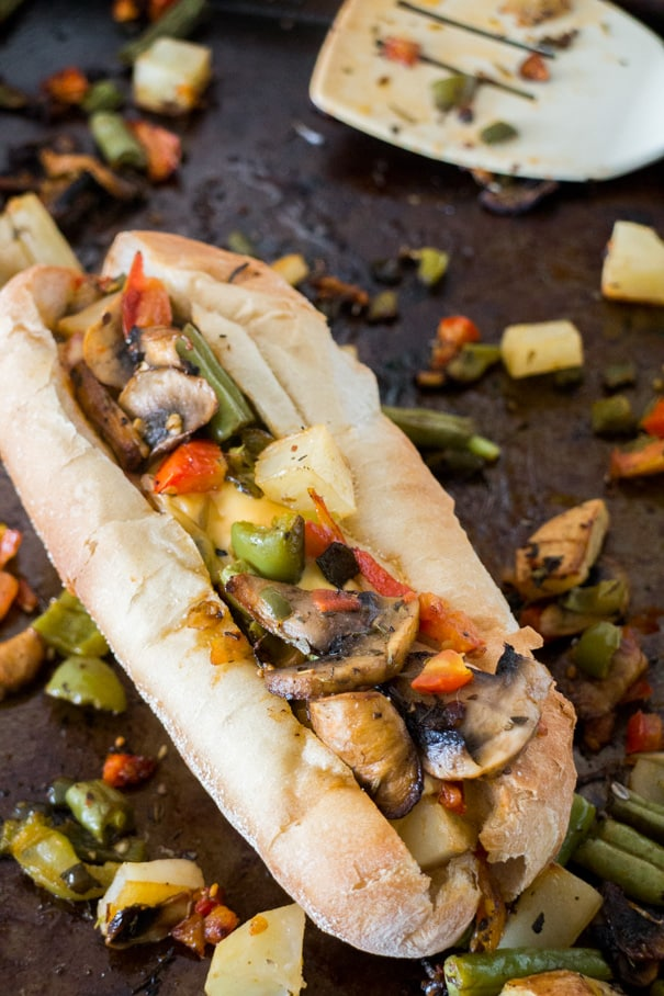 Healthy Roasted Vegetable Sandwich recipe that's filled with veggies. This easy to make vegetarian dinner meal is only 550 calories, including roll and cheese!