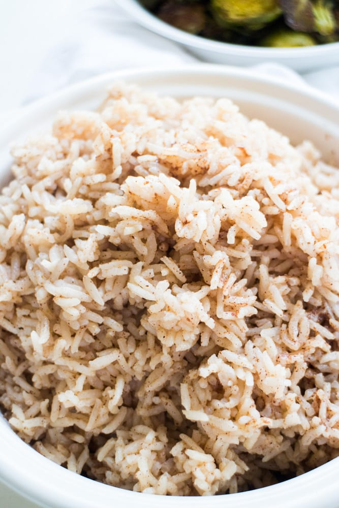 Learn how to cook PERFECT Indian Basmati Rice! This easy recipe uses basmati rice and fragrant spices to create authentic tasting Indian rice. Pair it with roasted vegetable to make a healthy, vegan meal for dinner!
