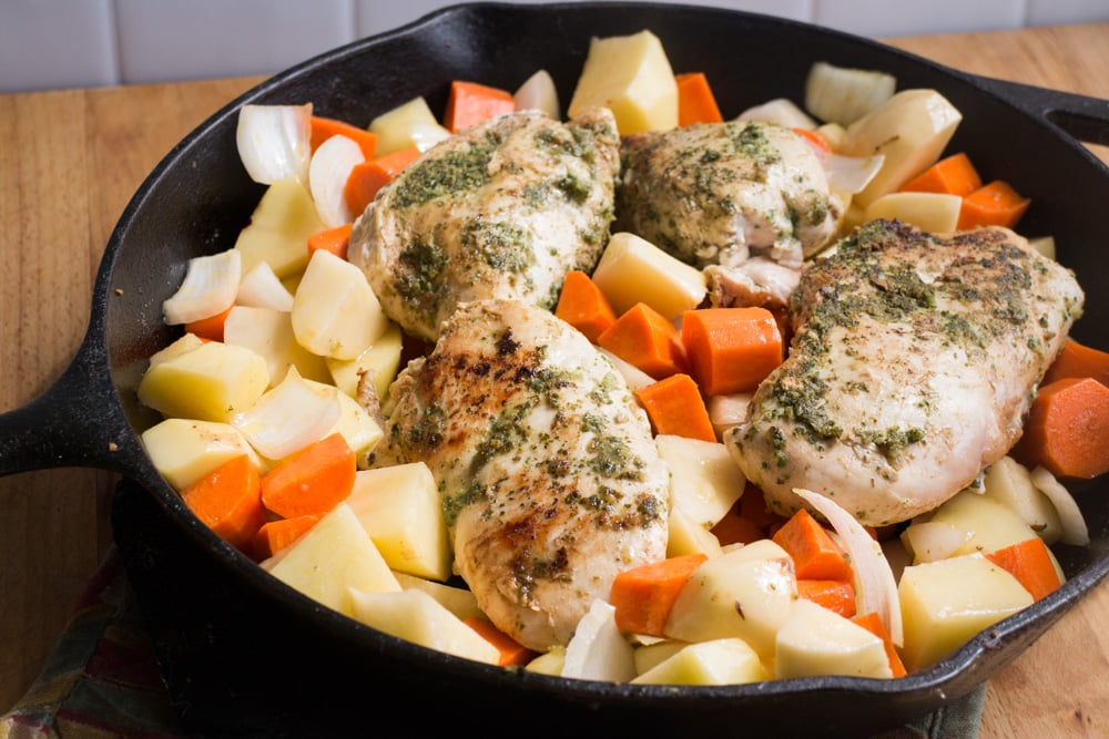 Cast Iron Chicken With Mint Chutney - this is a full meal recipe with vegetables!  This dinner dish uses fresh mint on baked chicken breasts, along with carrots, potatoes and onions!  Your entire family will love this healthy one skillet pan meal!