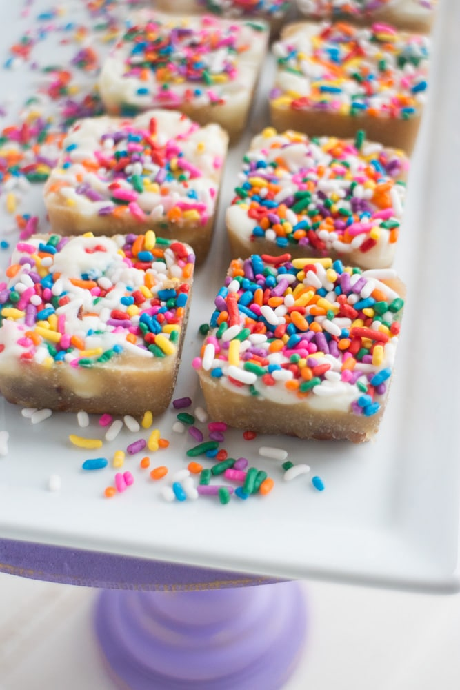 EASY White Chocolate Toffee Recipe with rainbow sprinkles! You're going to love this sticky homemade candy that has a base of crushed up pecans. Cut into squares or break up into bark!