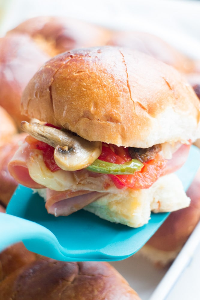 ITALIAN Ham and Turkey Sliders with ROASTED Vegetables on Hawaiian Sweet Rolls! This mini sandwich recipe is so easy to make and makes the perfect meal for dinner, potlucks and party finger foods!