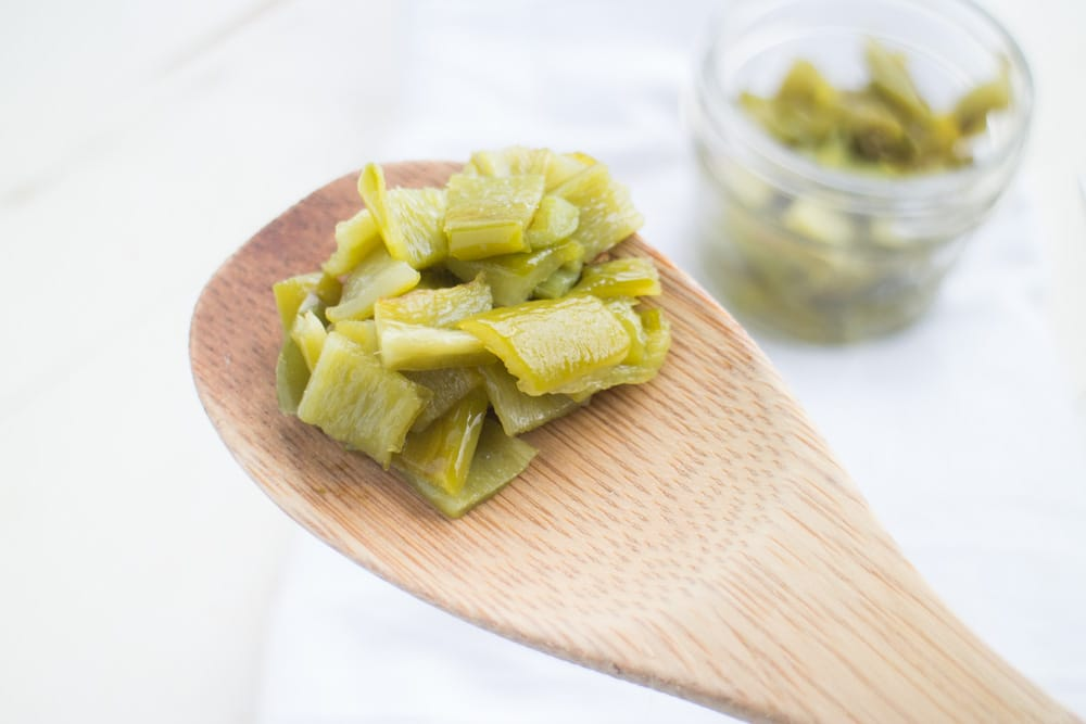 How to make DICED GREEN CHILES - just like the canned version you buy in the supermarket! SO EASY step by step instructions to make homemade green chiles! Perfect idea for your garden Anaheim peppers! Serve immediately, freeze or can them!