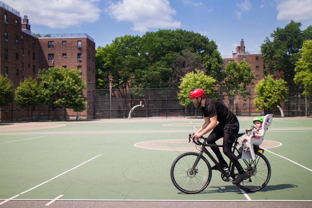 Full guide on bike riding with a baby! We started riding in NYC with our baby at 10 months old. Learn about the best baby bike seat, baby helmet and how to stay safe when cycling.