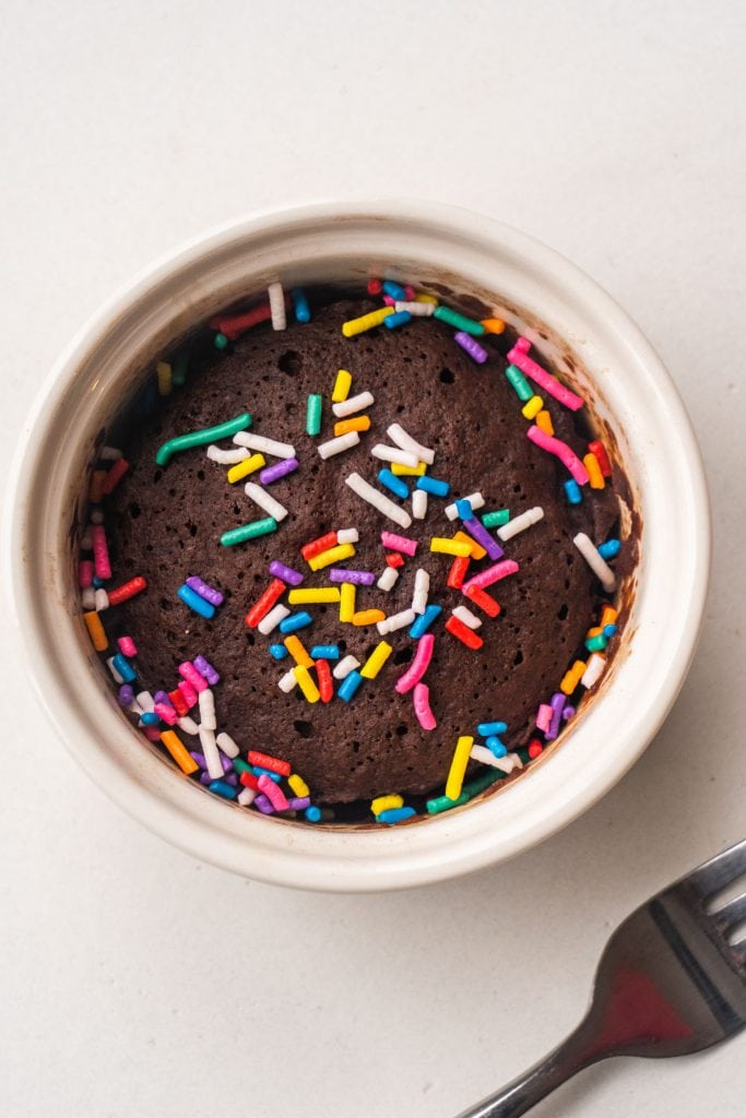 rainbow sprinkles on top of baked healthy chocolate brownie.