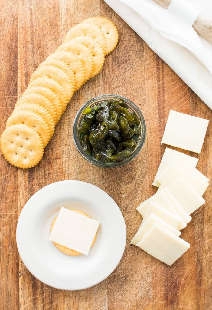 candied jalapenos with crackers and cheese spread