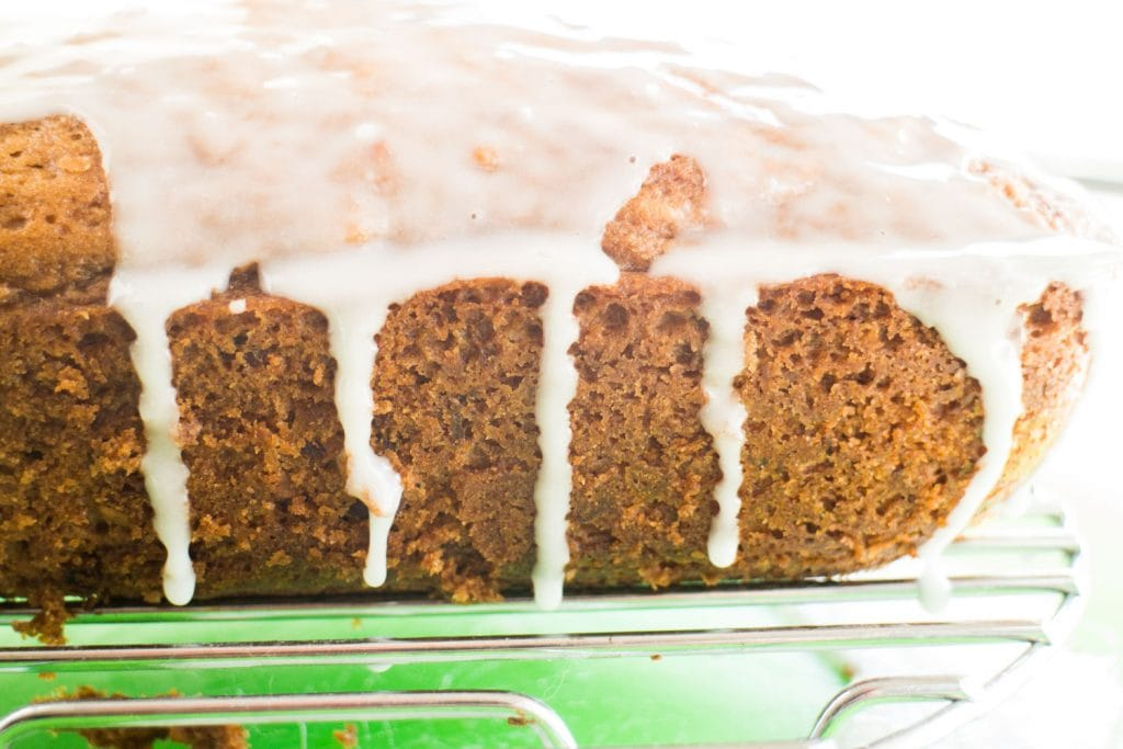 sugar icing running off of cucumber bread on cooling rack