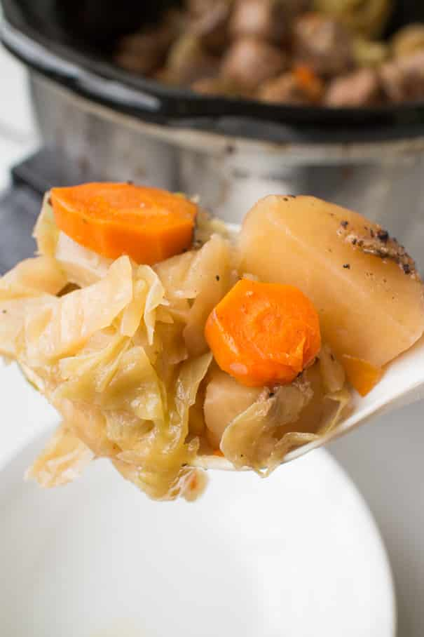 Slow Cooker Sausage and Cabbage is a easy crock pot recipe ready in 6 hours! Add Sweet Italian Sausage links and vegetables (potatoes, cabbage, carrots and onion!) into your slow cooker for a delicious comfort meal!