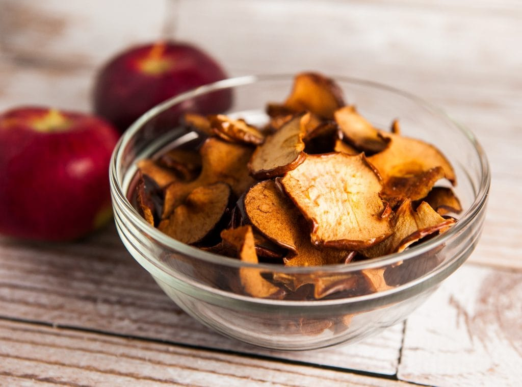 apple chips in bowl on table.