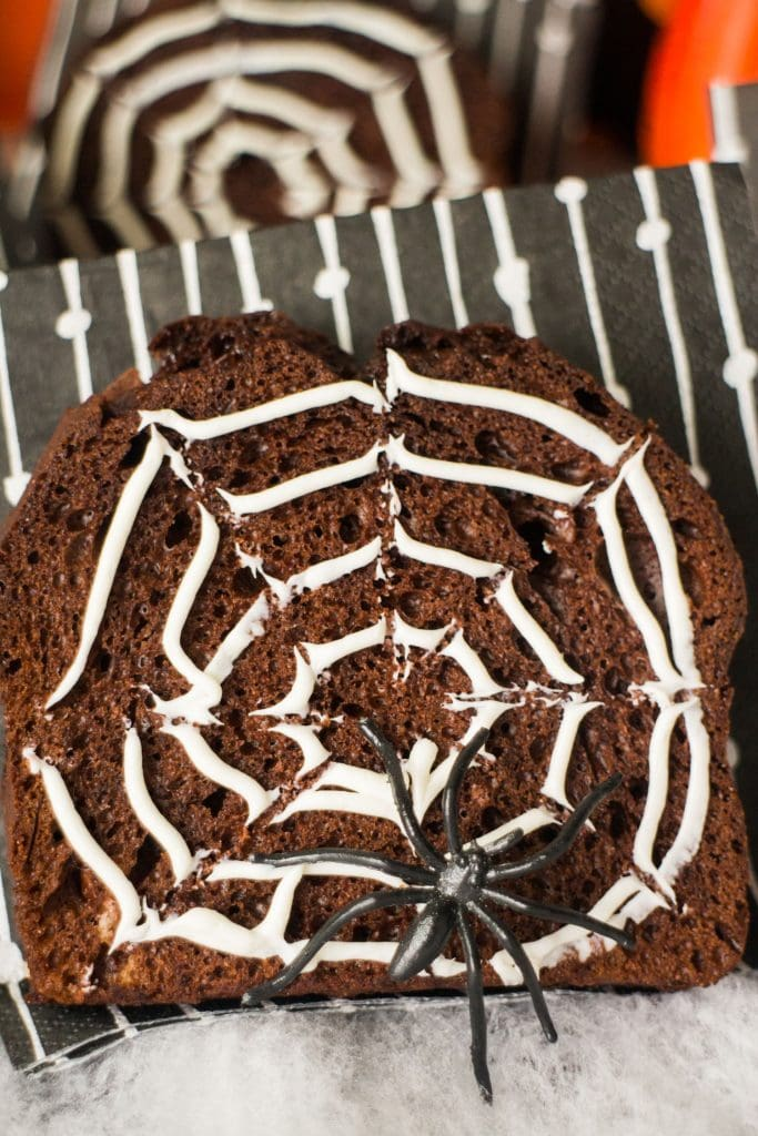chocolate bread with halloween black toy spider on it