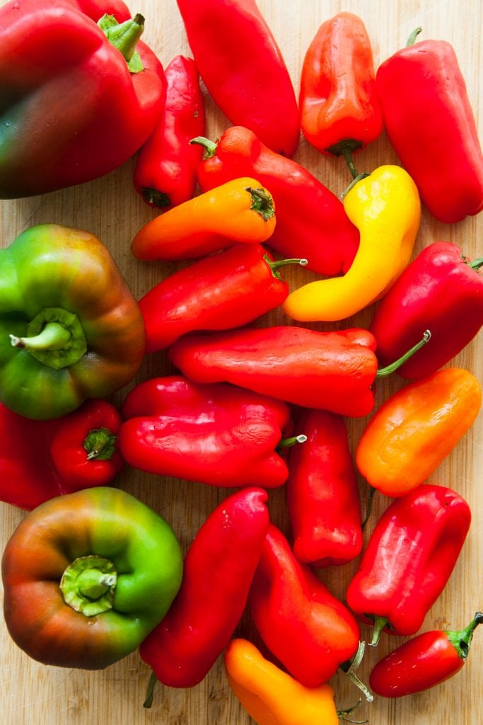 rainbow peppers on cutting board.
