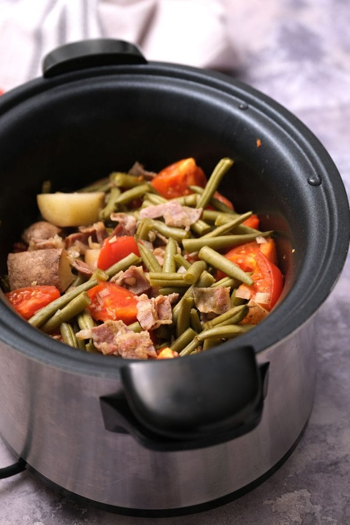 slow cooker green beans, potatoes, tomatoes and bacon in slow cooker