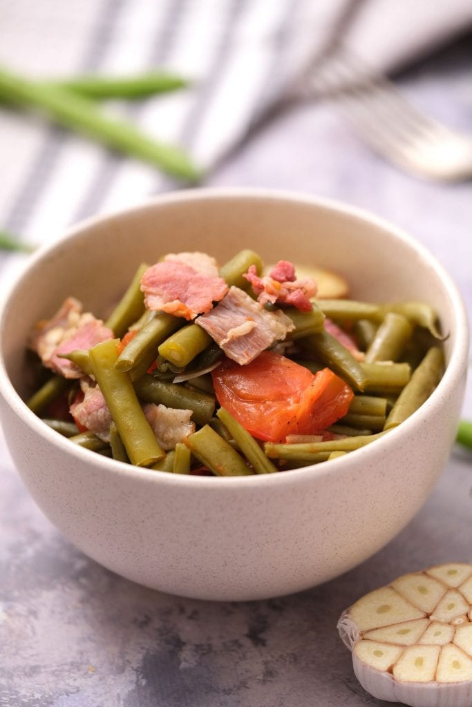 white bowl filled with slow cooker green beans on table