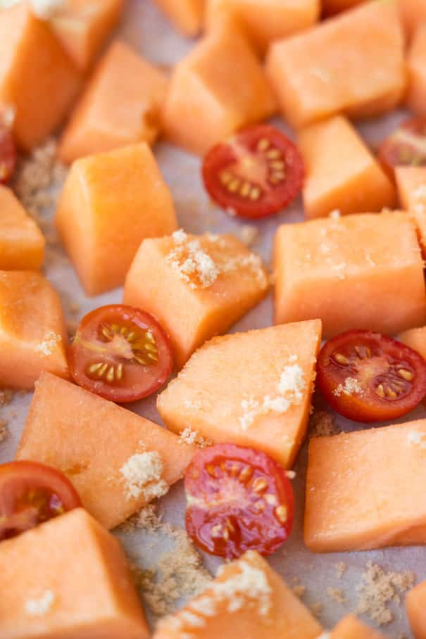 Healthy Roasted Cantaloupe Salad recipe made in 30 minutes.  It's an easy savory and sweet melon tomato salad! I love this recipe for our garden Summer fruit!  This salad is vegetarian, vegan and gluten free.