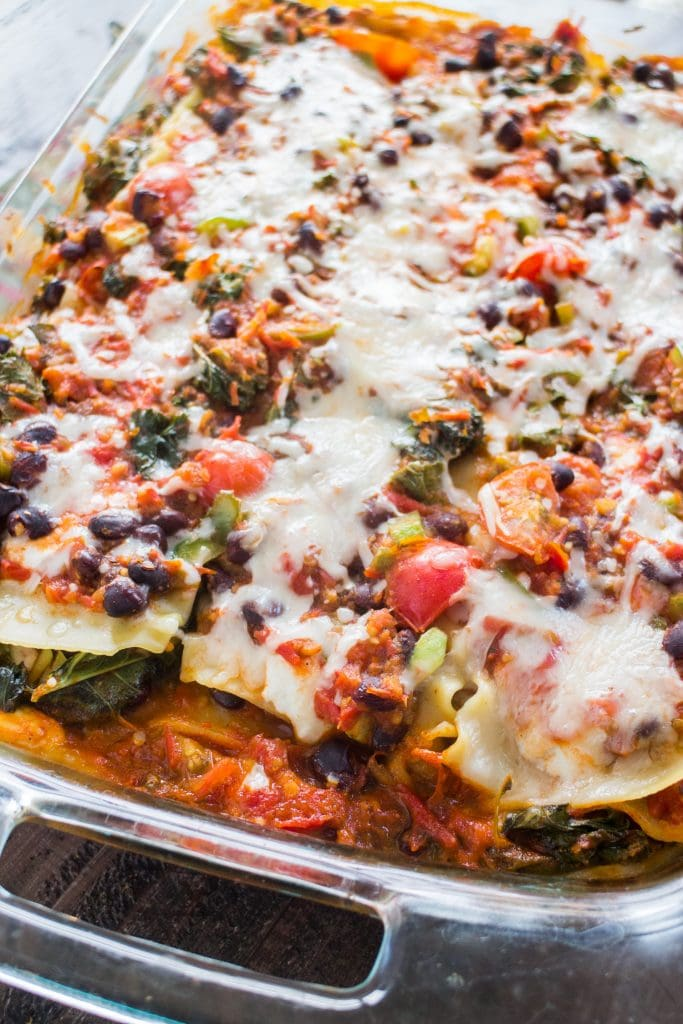 mexican lasagna with cheese and beans in lasagna dish