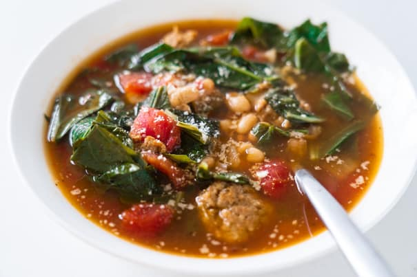 Italian Sausage Soup with collard greens, white beans and diced tomatoes. Your entire family is going to love this easy to make hearty soup, and even better it's only 180 calories a serving!  This creamy soup is dairy free, keto and low carb.