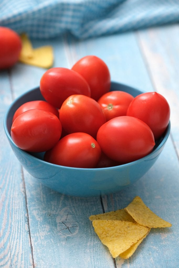 roma tomatoes in blue bowl