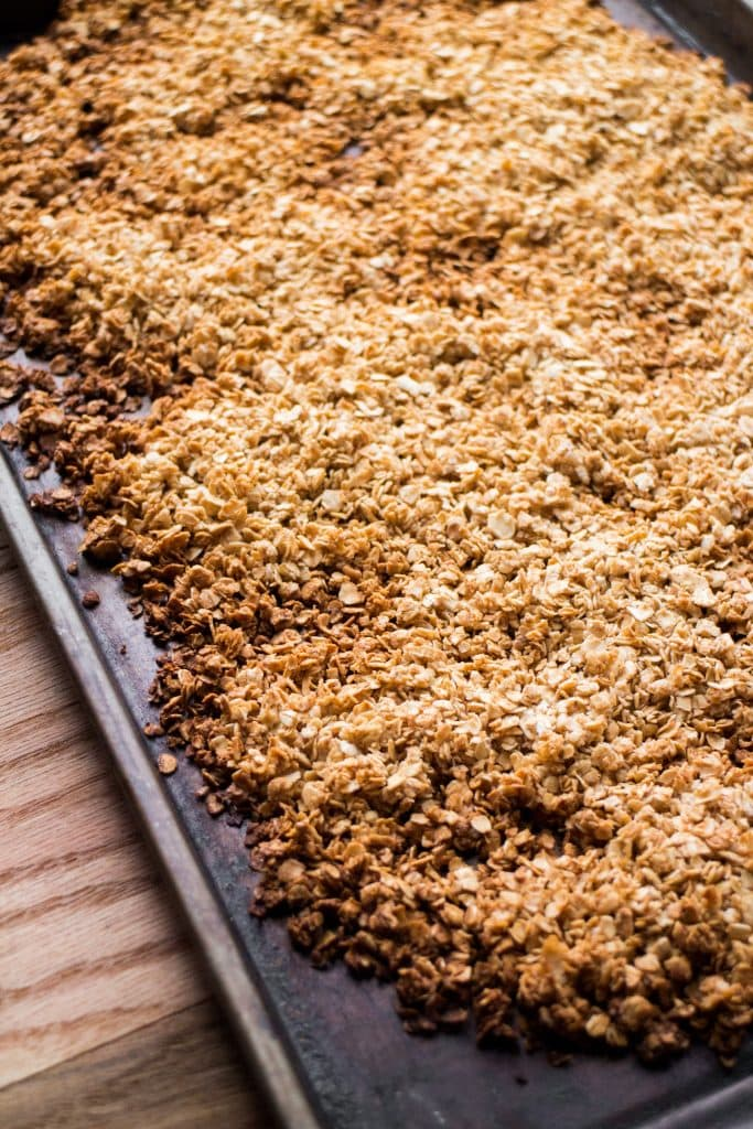 baked crispy granola on baking sheet.