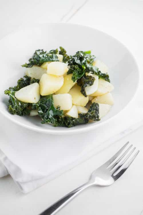 This easy recipe for Simple Potato Kale Salad is one of my favorite healthy meals or side dishes. The ingredients are straightforward: potatoes, kale, and olive oil – that's it! Paleo, Whole30-compliant, and vegan friendly.