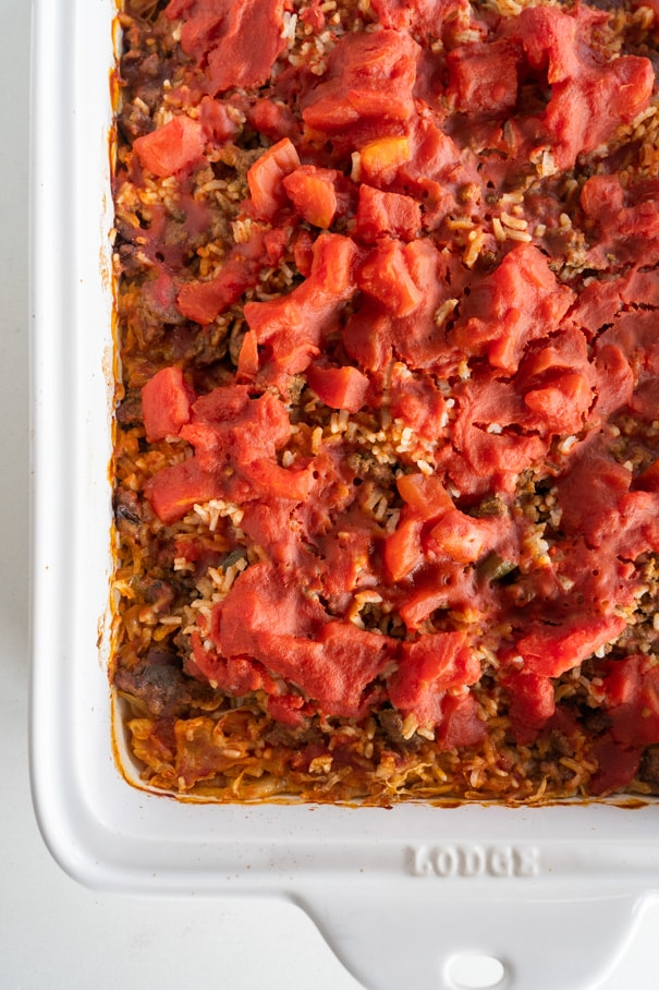 Cabbage Roll Casserole has all the same flavor as classic baked cabbage rolls, but with way less work! This unstuffed cabbage roll casserole combines layers of meat, rice, tomatoes and cabbage for an easy adaptation of the classic cabbage roll that is perfect for a busy weeknight meal!
