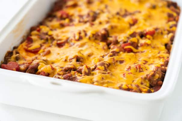 This Quesadilla Casserole is an easy Mexican casserole recipe that includes layers of tortillas, ground beef, black beans, corn and cheese, all baked together for dinner perfection. A quick and simple meal that the whole family will love!