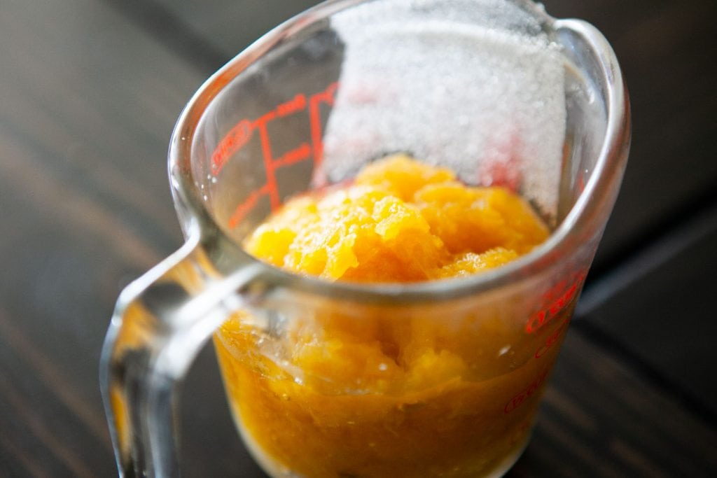 fresh pumpkin puree in measuring cup