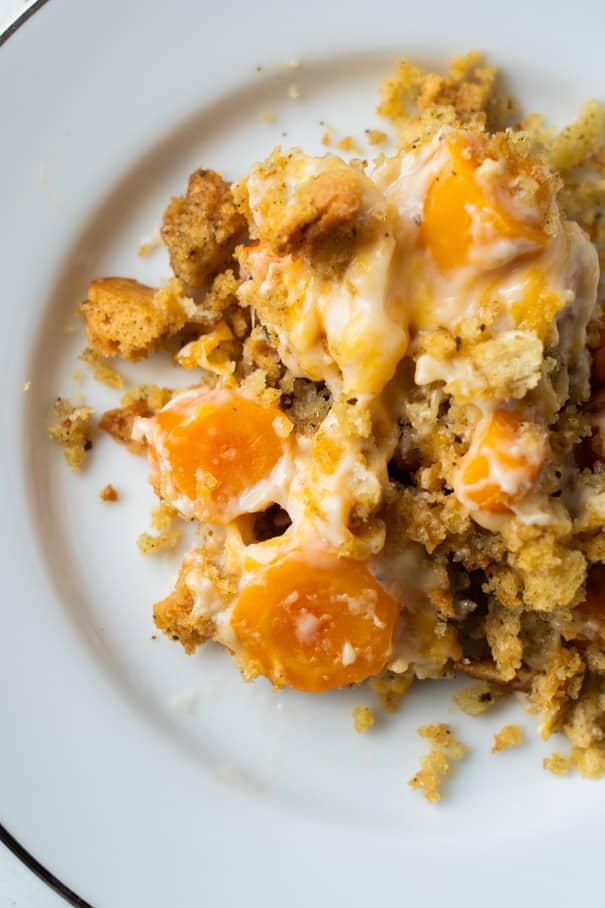 This Carrot Casserole is a super easy one-pot meal that combines tender carrot coins with cream of mushroom soup and cheese and is topped with a buttery herbed stuffing. A tasty and inexpensive side dish that's perfect for a holiday meal or an everyday dinner.