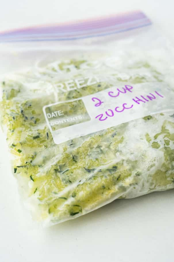 Easy step by step instructions on how to freeze zucchini without needing to blanch it. This quick method saves you time and freezes zucchini for up to a year. Perfect for making zucchini bread and treats with!