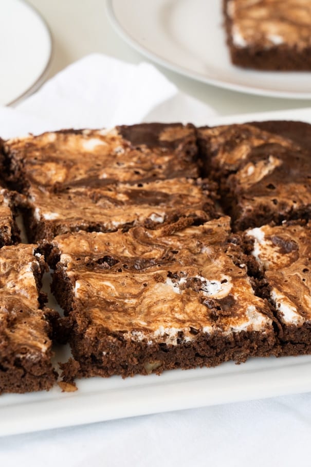 These Rocky Road Brownies are rich and fudgy bars loaded with walnuts and a layer of marshmallow fluff. A decadent treat that's easy to make and perfect for feeding a crowd.