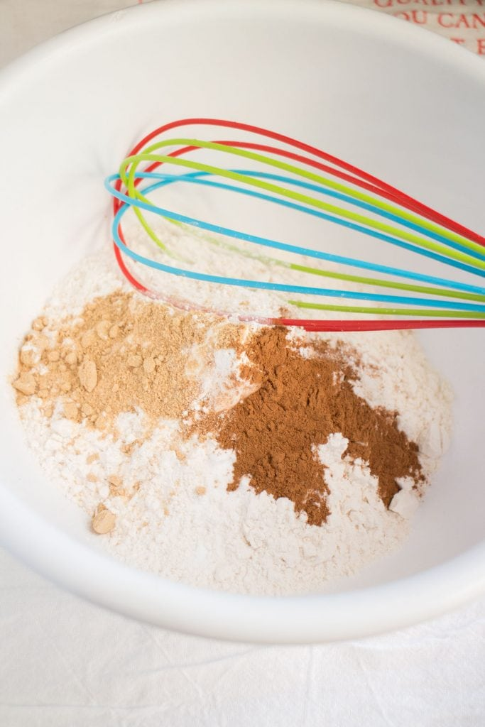 bowl of dry ingredients with whisk in white bowl