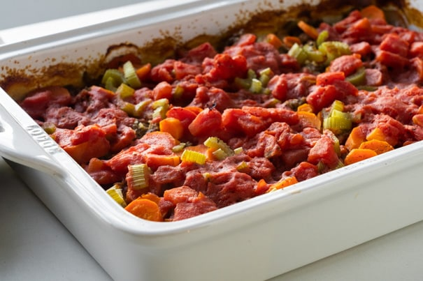 This ground beef casserole or commonly called Shipwreck Casserole is a comfort food meal that always gets rave reviews. This super easy version of the classic Shipwreck Casserole is made with ground beef, rice, potatoes and lots of veggies, baked together in the most delicious tomato sauce. This dinner is quick to throw together, and it freezes well too. This beef casserole is one of my favorite cozy winter meals!