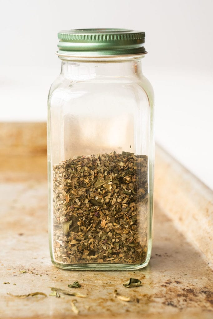 Easy step by step instructions on how to dry basil in the oven. This method quickly dries basil leaves in 45 minutes.