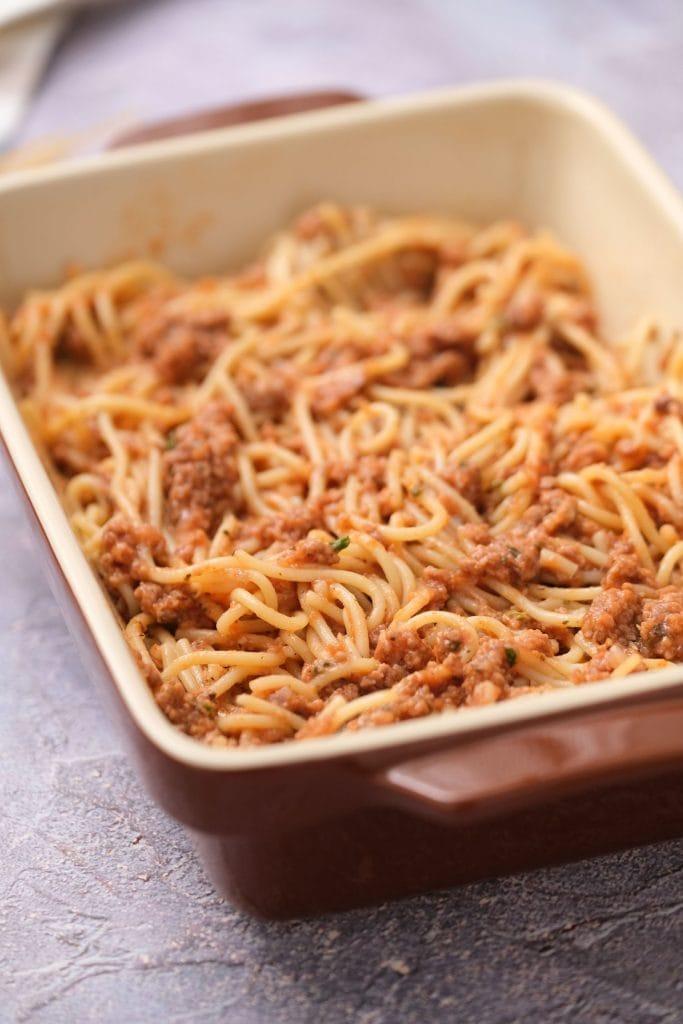 leftover spaghetti with pasta sauce on baking dish