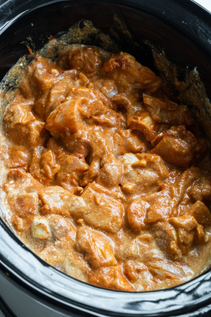 Easy, tasty Slow Cooker Butter Chicken recipe.  This authentic dinner tastes just like your favorite Indian restaurant, ready in 4 hours in the crockpot!  Serve with basmati rice and naan.