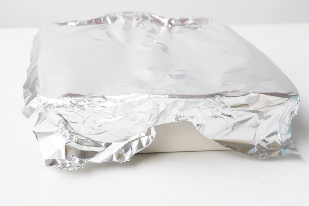 casserole dish covered with aluminum foil
