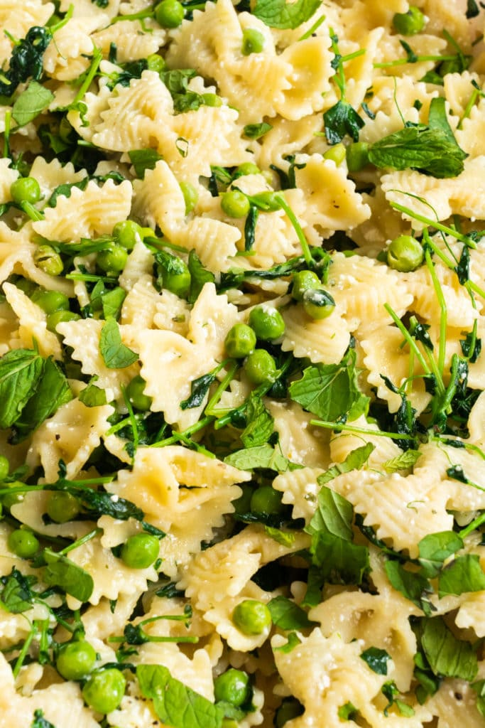 Simple Pea Shoots pasta recipe that's delicious and healthy! Farfalle pasta is mixed with pea shoots, peas and Parmesan cheese to make a 30 minute easy recipe that your family will love!