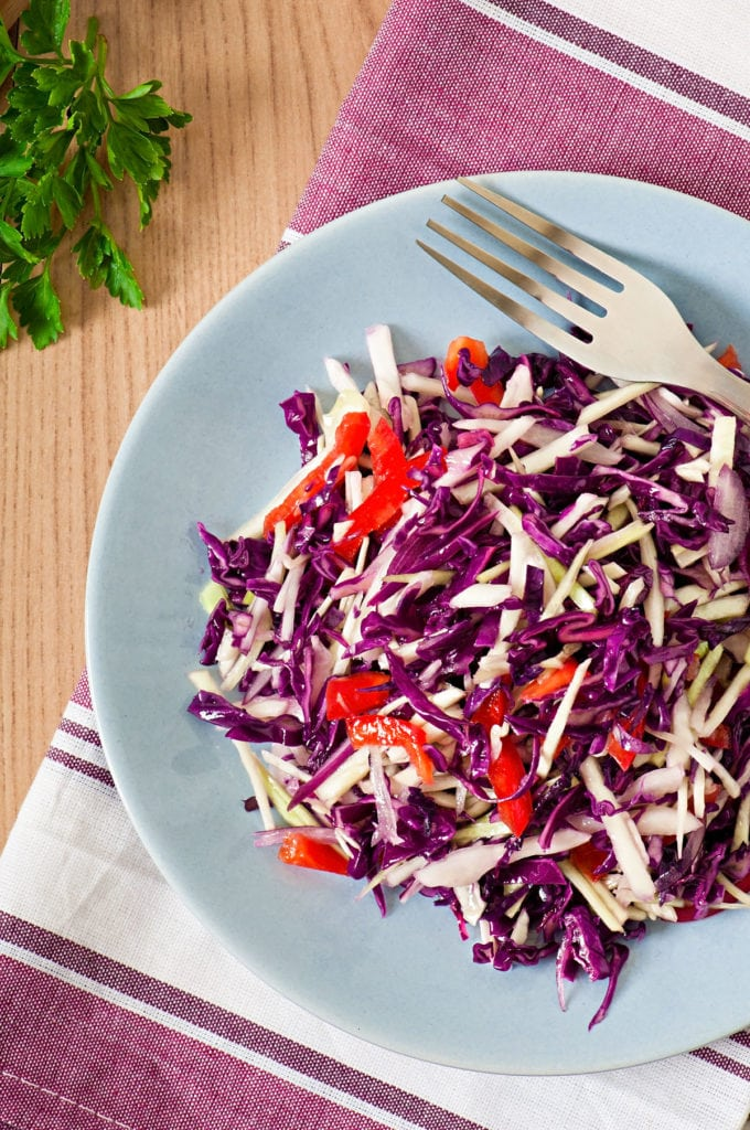 Easy healthy Red Cabbage Salad with red bell peppers and onions.  Homemade dressing is made with apple cider vinegar, lemon juice and olive oil.  Delicious clean eating salad!