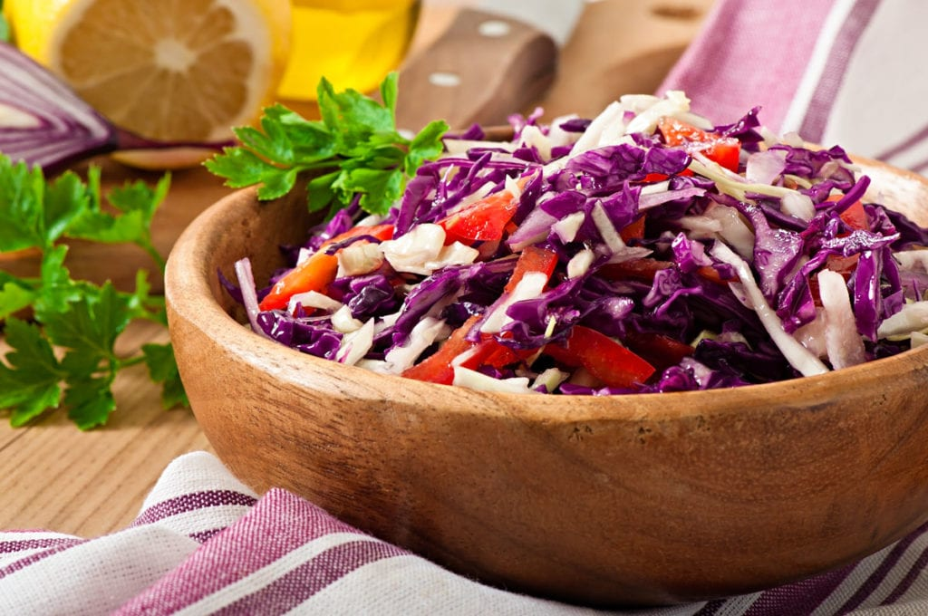 Easy healthy Red Cabbage Salad with red peppers and onions.  Homemade dressing is made with apple cider vinegar, lemon juice and olive oil.  Delicious clean eating salad!
