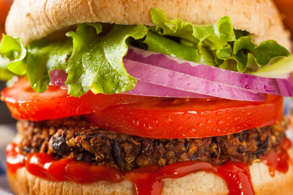 Best Vegetarian burger made with quinoa and black beans!  Burgers are baked in the oven to make more healthy. This easy recipe results in a juicy burger that even meat eaters will love!