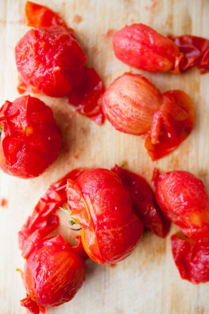 tomatoes peeled on cutting board